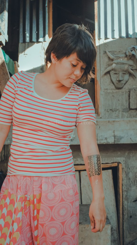 Tara showing off her tattoo by Apo Whang-od